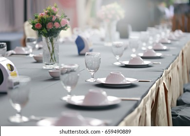 table setting in restaurant.Banquet table decor. Candles in vases and flowers.selective focus.