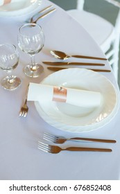 table setting with spoon, knife, plates and glass, restaurant, ceremony or wedding table