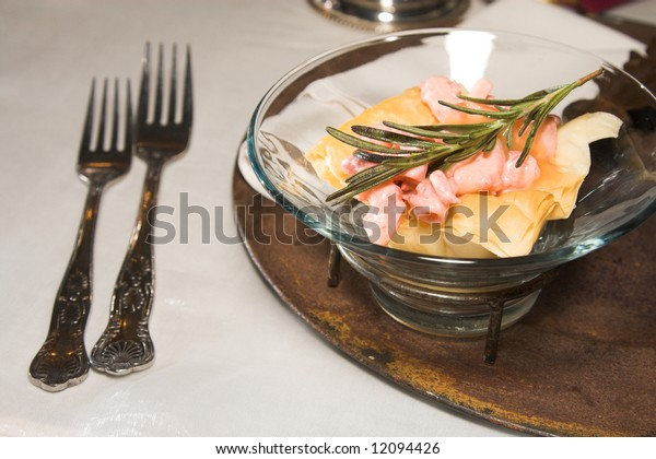 Table setting at a wedding with a meat dish