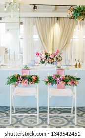 Table settings for a luxury wedding reception. Indoor wedding