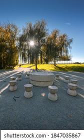 Table of Silence (Masa tacerii) scupture made by Constantin Brancusi in Targiu Jiu, Romania - Autumn sunset view