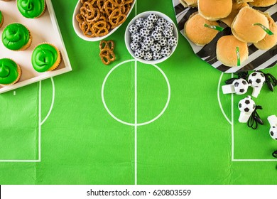 Table with snacks for football party.