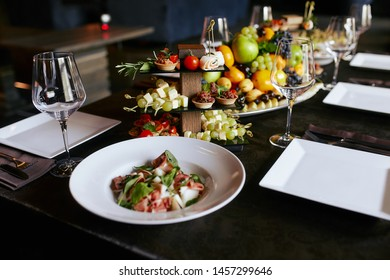 table with snacks in a restaurant for 6 persons
