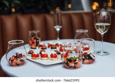 Table with snacks and wine