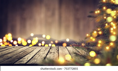 A table with space for your advertisement. Christmas tree with lights. House Interior.