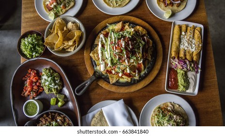 Table Spread of Family Style Mexican Food Dishes at a Restaurant