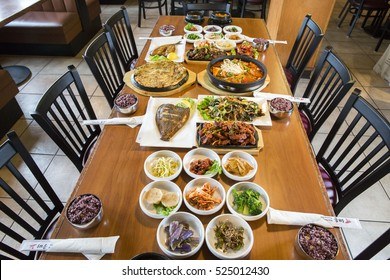 A Table Spread of Korean Banchan Vegetables and Food Served Family Style