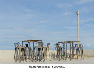 Table and steel deck chairs