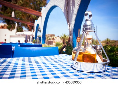 A table with a tablecloth at a Greek restaurant, Rhodos, Greece
