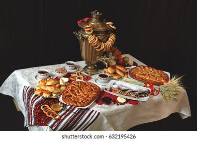 Table for tea. A samovar with pies.