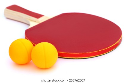 Table tennis ball with bat over white background