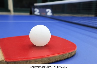 Table tennis ball and racket