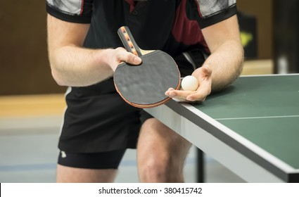 table tennis player serving - focus at the blade and ball / small depth of focus