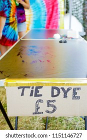 A table at a tie-dye workshop at an outdoor event in the UK