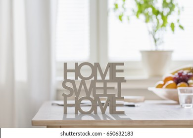 Table top with 3D letters making the words home sweet home - Shutterstock ID 650632183