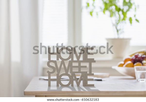 Table top with 3D letters making the words home sweet home