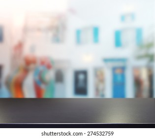 Table Top And Blur Building Of Background