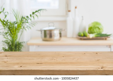 Table top with blurred kitchen interior as background