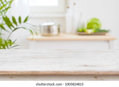 Table top and blurred kitchen room as background - Shutterstock ID 1005824815