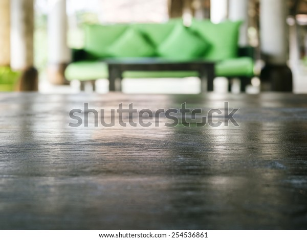 Table top with Blurred living room sofa background