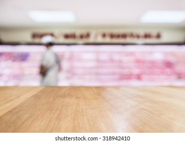 Table Top counter with Blurred Fresh food Meat display in Supermarket