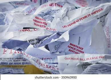 A table top covered in final demands, refusals and debt collection letters