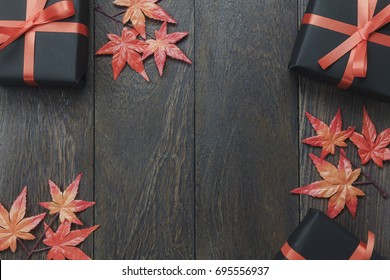 Table top of decoration sign Happy Halloween festival background.the gift or present and maple leaf  on rustic wooden background.Copy space for text information.Dark tone design.autumn.