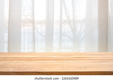 Table top with Defocused curtain window and stationery box with sunlight. For montage product display or design key visual layout.