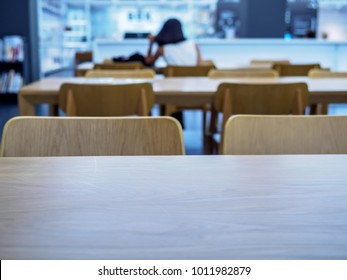 Table top over blurred background in the library / Education & Back to school concept