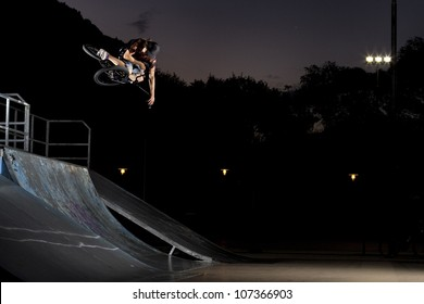 Table top in a skatepark, bmx bike trick on a quarter pipe