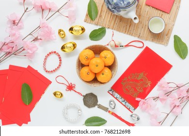 Table top view aerial of accessories and Chinese new year and Lunar new year festival concept background.Difference items on  white wood at office desk.Other language mean rich or wealthy and happy.