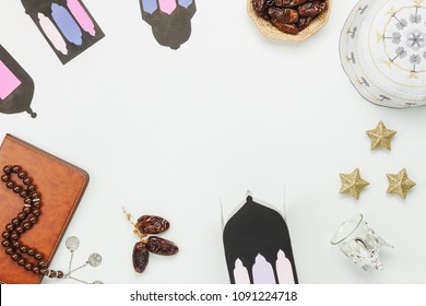 Table top view aerial image of decoration Ramadan Kareem holiday background.Flat lay date in wood basket with white rosary & green tea.Halal meal set for fasting is obligatory for Muslim on wooden.