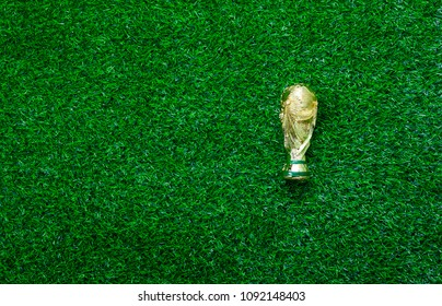 Table top view aerial image soccer or football season background concept.Flat lay accessories trophy on the artificial green grass wallpaper.Free space for creative design text and content wording.