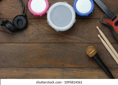 Table top view aerial image of music instrument background concept.Flat lay objects musical toy tools for development kids on modern rustic brown wooden.Copy space for creative design add text.
