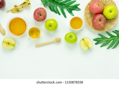 Table top view aerial image of decorations Jewish holiday the Rosh Hashana background concept.Flat lay of variety apple & honey bee on modern rustic white wooden.Free space for creative mock up.