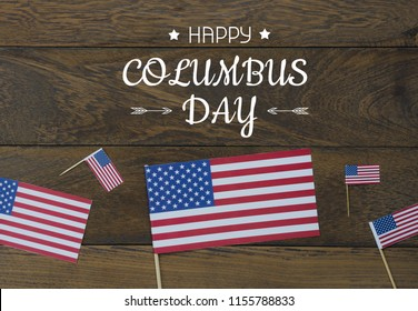 Table top view aerial image of decoration the sign of USA Happy Columbus day on Oct 8,2018 background concept.Flat lay accessories US flag and content or wording season on modern rustic brown wooden.