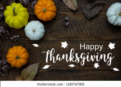 Table top view aerial image of decoration Happy Halloween or Thanksgiving day background concept.Flat lay accessory object to party the pumpkin & dry flower on brown wooden.Text for season design.