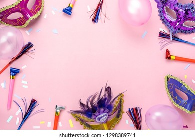Table top view aerial image of beautiful colorful carnival season or photo booth prop Mardi Gras background.Flat lay objects colorful mask with confetti and decorations to party on pink paper.