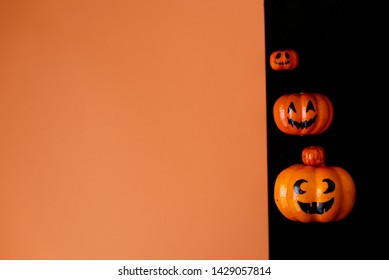 Table top view aerial image of decoration Happy Halloween day background concept.Flat lay accessories essential object to party the pumpkin sweet candy on white wooden.Space for creative design.