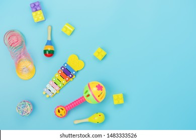 Table top view decoration kid toys for develop background concept.Flat lay accessories baby to play with items child on modern blue paper at office desk.Copy space for add text.pastel tone wallpaper.