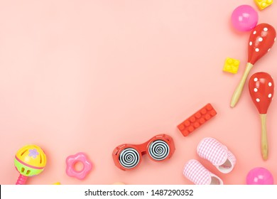 Table top view decoration kid toys for develop background concept.Flat lay accessories baby to play with items child on modern pink paper at office desk.Copy space for add text.pastel tone wallpaper.