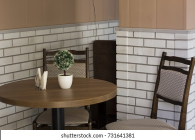 Table and two chairs, dining room interior
