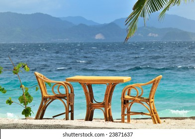 Table with two chairs at the sea shore