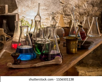 Table with various alchemist equipment.