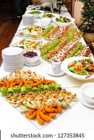 Table with various delicious appetizer