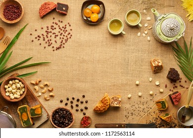 Table with various ingredients for traditional Asian moon cakes, view from above