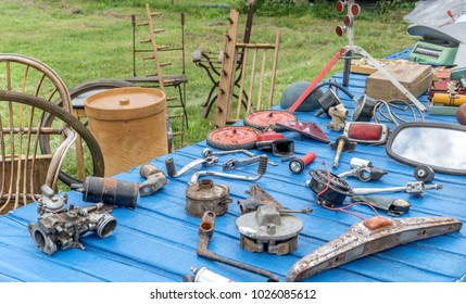 Table with various tools and objects at a flea market