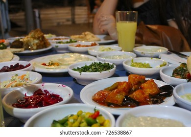 Table with various traditional food served in restaraunt in Israel