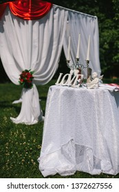 Table for the wedding ceremony of the bride and groom, decorated with letters of love, a statue of an angel, and a candlestick candelabrum.