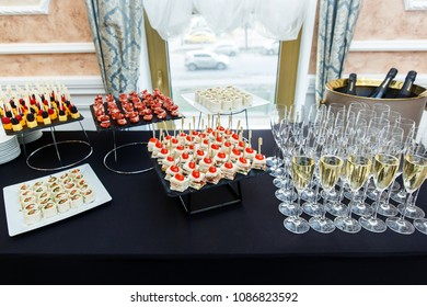 Table with wine glasses, canape